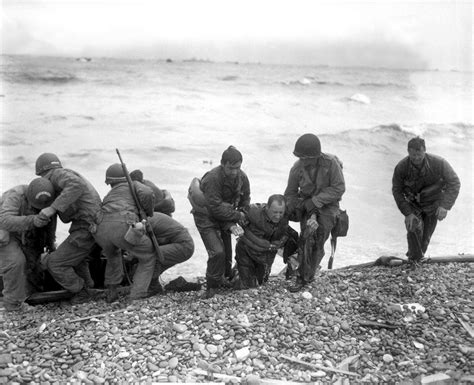 D-Day landings: Powerful photos of Allied troops storming